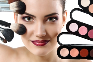 Model with make-up brushes