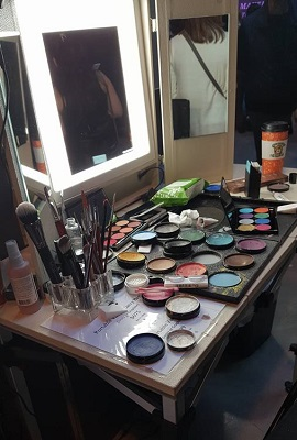 A vanity with makeup